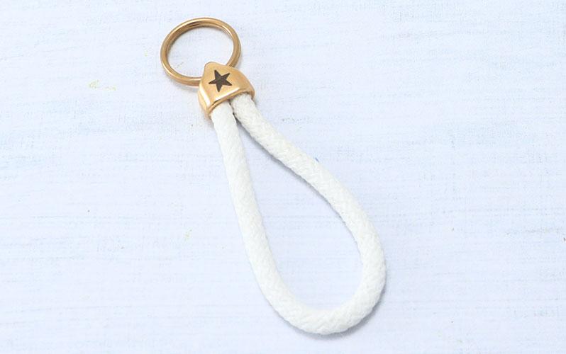 """Schlüsselanhänger mit Segeltau und Gravur """"Stern"""" vergoldet"""