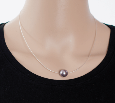 Schwebende Perle mit Kalotten